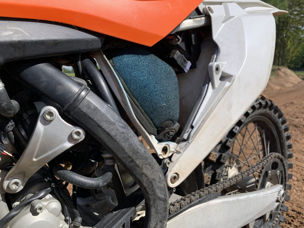 What aspects should I watch out for with cheap used dirt bikes?